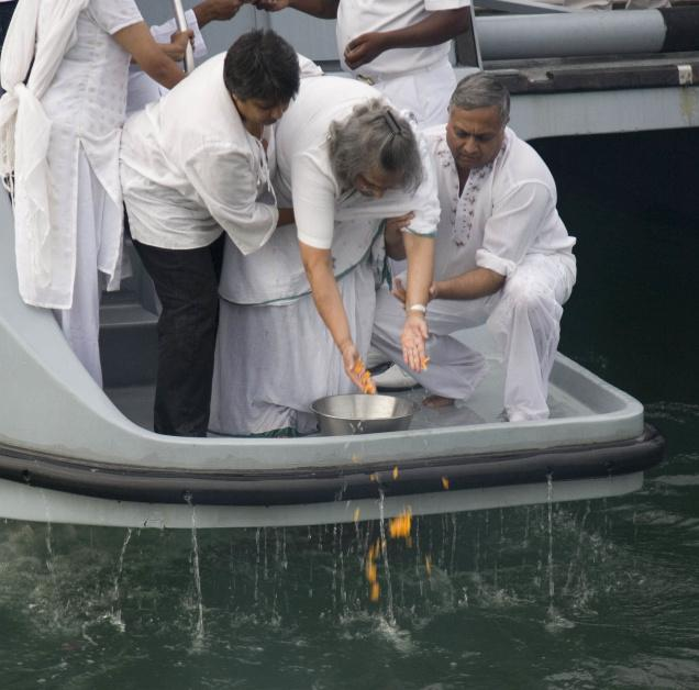 Ela Gandhi, the granddaughter of Mahatma Gandhi (C) is helped by others during a ceremony to sprinkle the ashes of Bapu into the waters of Durban Harbour, South Africa. (Source: DPA/AP - The Hindu - http://bit.ly/aqhy6E )
