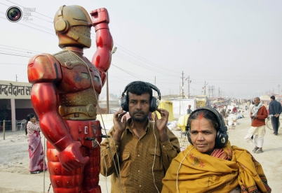 Hindu devotees wearing headsets listen to a fortune-telling machine at Sangam...
