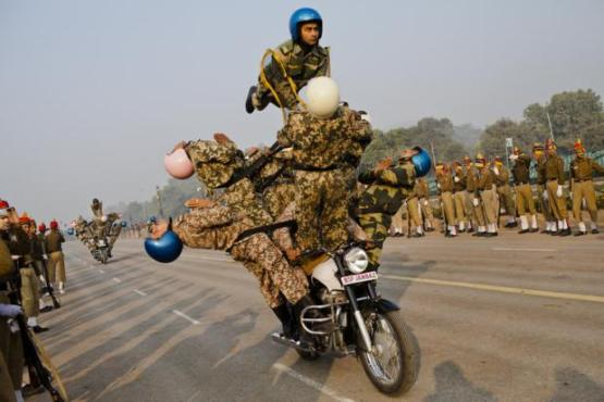 Indian soldiers form up on their Royal Enfield motorcycles to human pyramids.