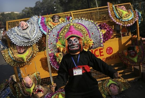 An Indian student dressed in a mask jokes-photo-Kevin-Frayer