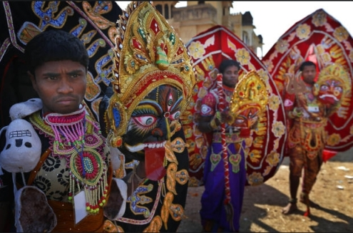 Men wearing festive dresses from the eastern Indian state of Orissa