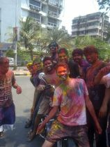 Group Playing Holi in Vashi, Navi Mumbai, India (Source: Wikipedia.org)