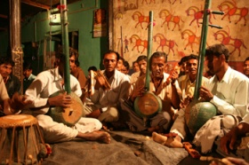Rathwa Thambouro Players in Front of a Pithora Painting