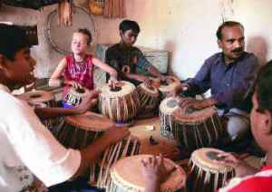 Tabla teacher Ravi Kudalgi with students at the Kalkeri Sangeet Vidyalaya  (PICTURE: K. BHAGYA PRAKASH | frontline.in)