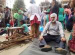 Injured people receive treatment outside the Medicare Hospital in Kathmandu, Nepal